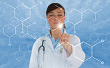Brunette doctor touching screen displaying chemical formula