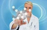 Doctor touching touchscreen displaying hologram