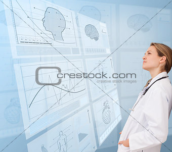 Thoughtful doctor looking at a medical new technology