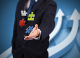 Businessman with digital puzzles