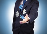 Businessman with digital white and blue puzzles