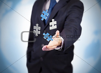 Businessman with digital puzzles levitating