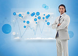Businessman standing against a digital world map