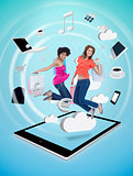 Two cute women jumping on a tablet pc