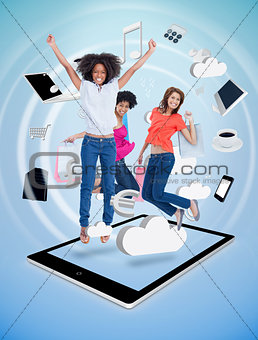 Three cute women jumping on a tablet pc