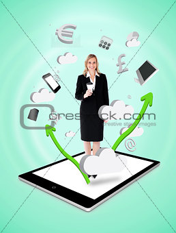 Happy businesswoman holding a coffee on a tablet pc