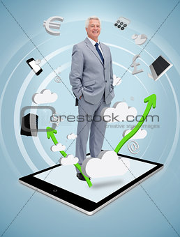 Smiling businessman standing on a tablet pc