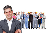 Smiling businessman ahead a group of people with different jobs