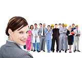 Smiling businesswoman ahead a group of people with different jobs