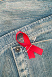 Aids awareness ribbon pinned to jeans