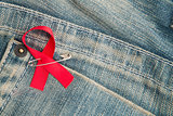 Aids awareness ribbon pinned on to jeans