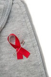 Aids awareness ribbon pinned on to grey hoodie