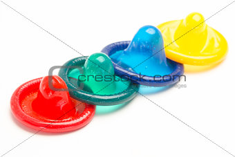 Four colourful condoms