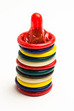 Stack of many colourful condoms