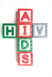 Wood blocks spelling aids and hiv in a cross shape