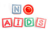 No aids spelled out in blocks and a condom