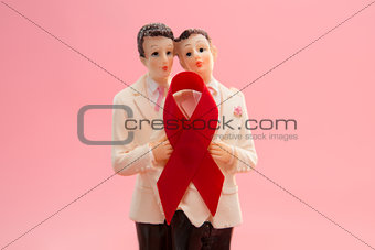 Gay groom cake toppers with red awareness ribbon