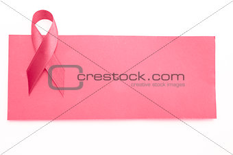 Blank pink card with pink ribbon