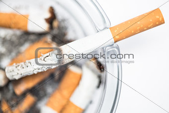 Close up of cigarette in ashtray