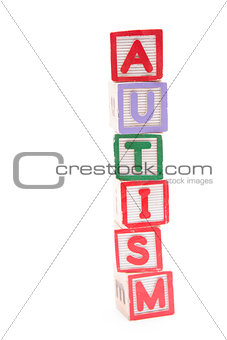 Autism spelled out in stacked letter blocks