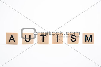Autism spelled out in plastic letter pieces