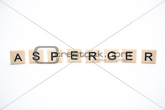 Asperger spelled out in plastic letter pieces