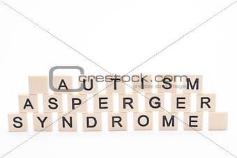 Autism asperger syndrome spelled out in plastic letter pieces