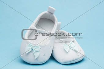 Baby booties with blue ribbon