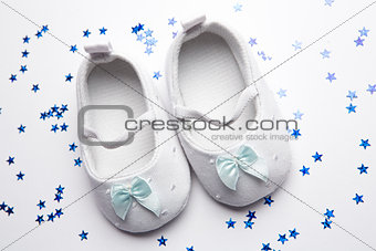 Baby blue booties with confetti