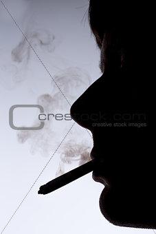 Close up silhouette of smoking man