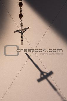 Crucifix casting a shadow