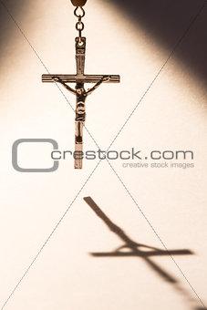 Cross casting a shadow
