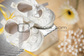 Baby booties on gift box
