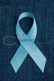 Blue ribbon for prostate cancer awareness on demin