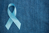 Blue ribbon for prostate cancer awareness on demin with copyspace