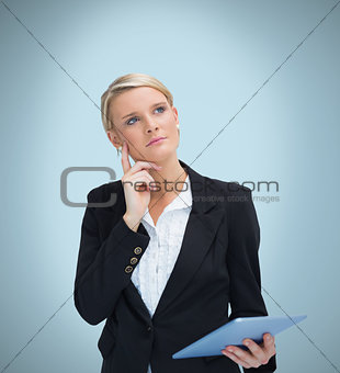 Thoughtful businesswoman with tablet pc