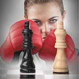 Female boxer behind the chess board