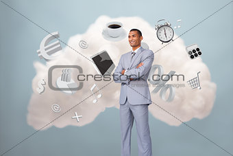 Businessman standing with cloud computing symbol