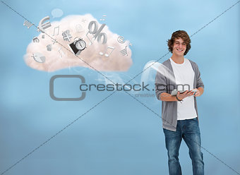Casual young man using tablet for cloud computing