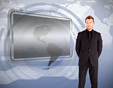 Businessman standing against blank screen