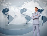 Businessman standing against world map interface