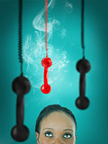 Woman looking up at hanging telephone receiver