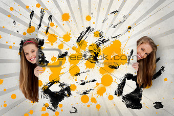 Two pretty girls holding abstract art