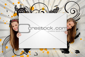 Pretty girls holding blank advertisement space