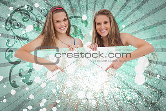 Pretty girls pointing to advertisement card