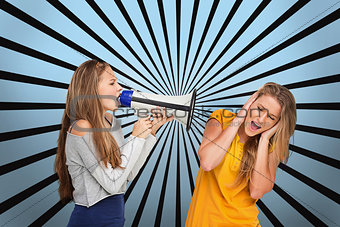 Girl shouting at another through megaphone while she covers her ears
