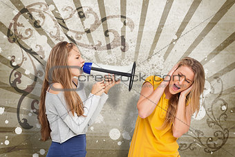 Girl shouting at another through a megaphone