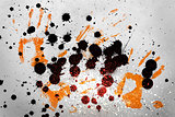 Orange hand prints with ink blots