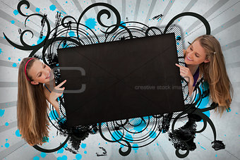 Girls pointing to black copy space on cursive design background