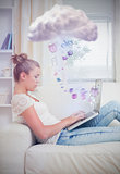 Attractive young woman connecting to cloud computing at home